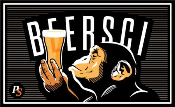 Macaco segurando copo de cerveja