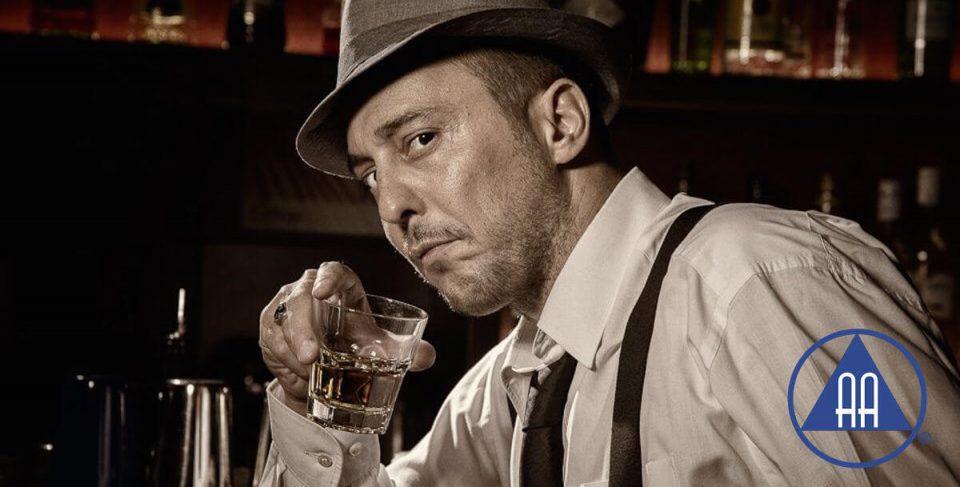 homem bebendo e marca dos alcoólicos anônimos